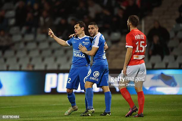 Julien Faussurier and Neal Maupay of Brest celebrates the second goal by Julien Faussurier during the French LIgue 2 match between Nimes and Brest at...