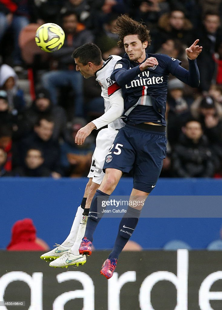 Julien Feret of Caen and Adrien Rabiot of PSG in action during the French Ligue 1 match between Paris SaintGermain FC and Stade Malherbe Caen at Parc...