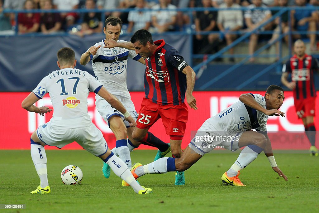 Julien Feret of Caen and Sebastien Squillacci and Alexander Djiku of Bastia during the French Ligue 1 match between SM Caen an Bastia at Stade Michel...