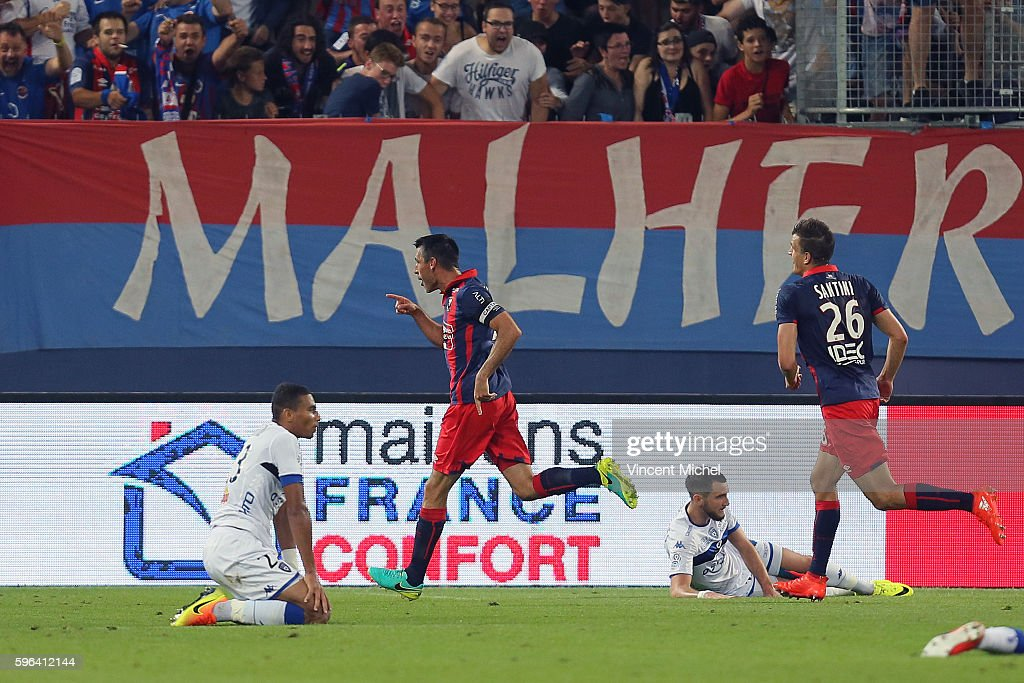 Julien Feret of Caen jubilates as he scores the first goal during the French Ligue 1 match between SM Caen an Bastia at Stade Michel D'Ornano on...