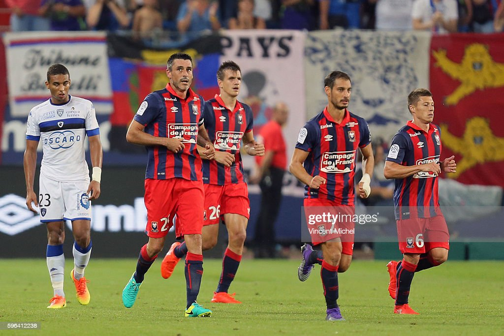 Julien Feret of Caen jubilates with teammates after scoring the first goal during the French Ligue 1 match between SM Caen an Bastia at Stade Michel...
