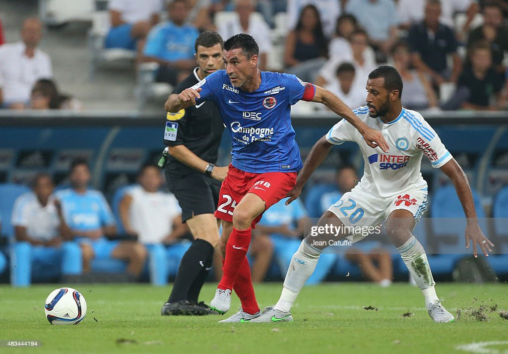 Julien Feret of SM Caen and Alaixys Romao of OM in action during the French Ligue 1 match between Olympique de Marseille and SM Caen at Stade...