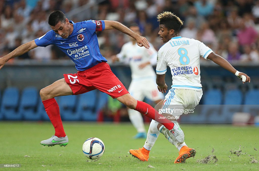 Julien Feret of SM Caen and Mario Lemina of OM in action during the French Ligue 1 match between Olympique de Marseille and SM Caen at Stade...