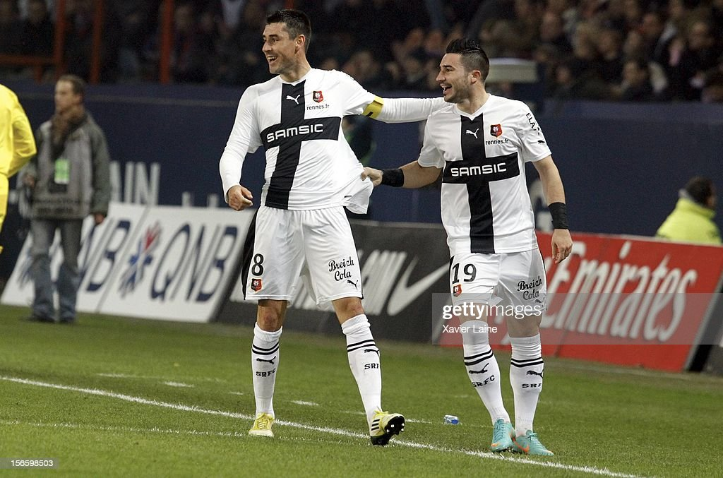 Julien Feret (L) of Stade Rennais celebrates his goal with Romain Alessandrini during the French Ligue 1 match between Paris Saint-Germain FC and Stade Rennais FC, at Parc des Princes on November 17, 2012 in Paris, France.