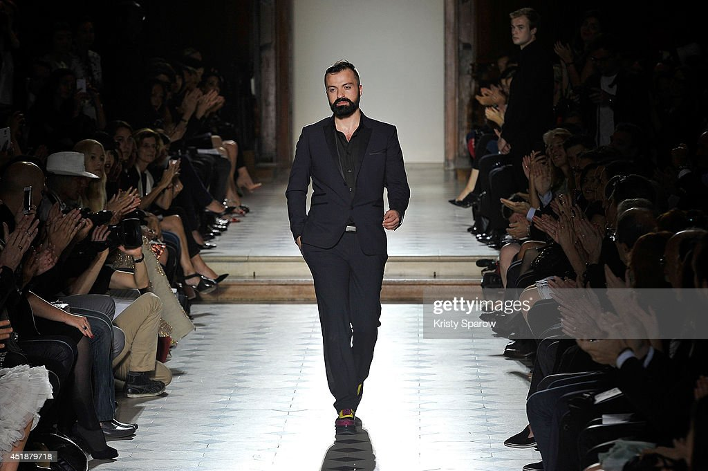 Julien Fournie acknowledges the audience during the Julien Fournie show as part of Paris Fashion Week Haute Couture Fall/Winter 20142015 at Oratoire...