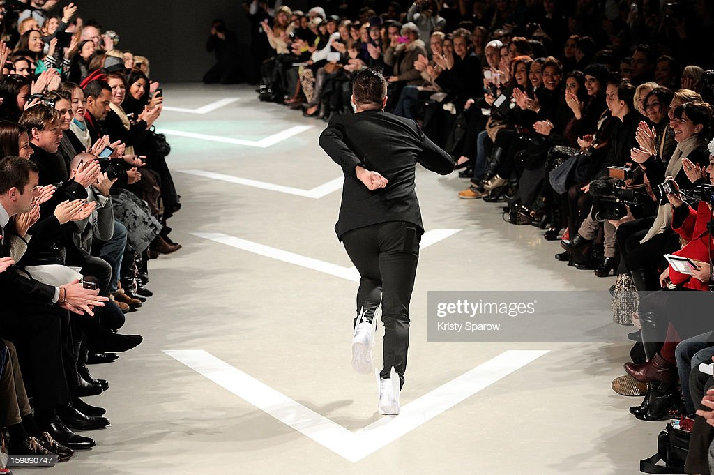 Julien Fournie acknowledges the public following the Julien Fournie Spring/Summer 2013 Haute-Couture show as part of Paris Fashion Week at Cite de l'Architecture et du Patrimoine on January 22, 2013 in Paris, France.