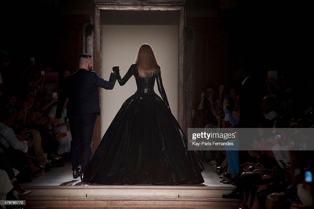 Julien Fournie and a model walk the runway during the Julien Fournie show as part of Paris Fashion Week Haute Couture Fall/Winter 2015/2016> on July...