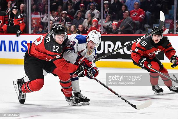 Julien Gauthier of Team Canada and Kieffer Bellows of Team United States skate against each other during the 2017 IIHF World Junior Championship gold...