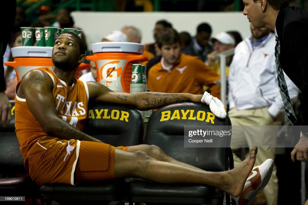 Julien Lewis #14 of the University of Texas Longhorns gets medical treatment on the bench against the Baylor University Bears on January 5, 2013 at the Ferrell Center in Waco, Texas.