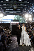 Julien Macdonald and a model on the runway at the Julien Macdonald show during London Fashion Week Spring/Summer 2016 on September 19 2015 in London...