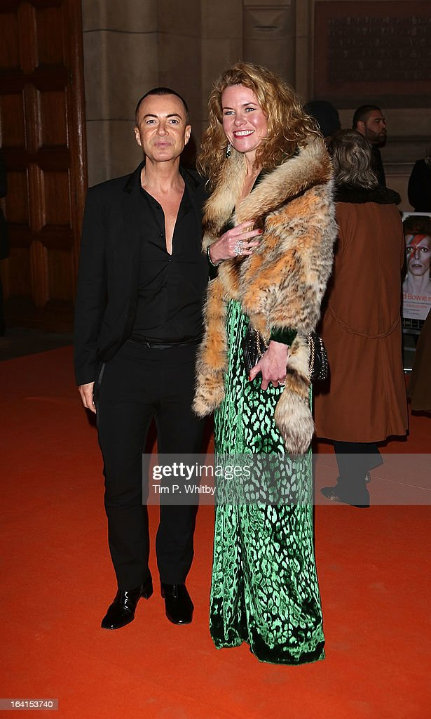 Julien Macdonald and guest attend the private view of 'David Bowie Is' at Victoria & Albert Museum on March 20, 2013 in London, England.