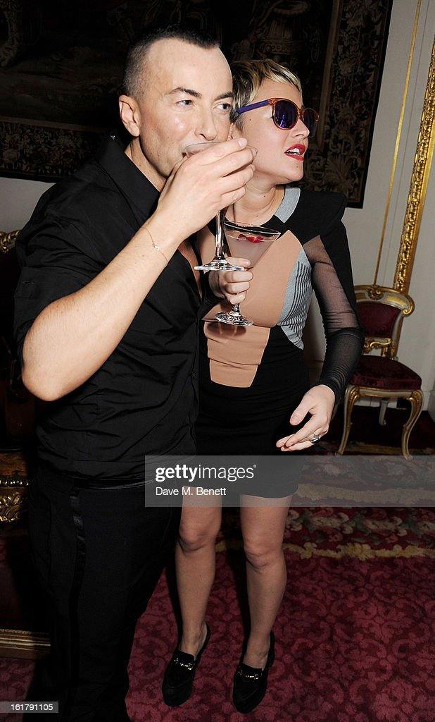Julien Macdonald (L) and <a gi-track='captionPersonalityLinkClicked' href=/galleries/search?phrase=Jaime+Winstone&family=editorial&specificpeople=834918 ng-click='$event.stopPropagation()'>Jaime Winstone</a> celebrate backstage at the Julien Macdonald show during London Fashion Week Fall/Winter 2013/14 at Goldsmiths' Hall on February 16, 2013 in London, England.