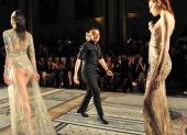 Julien Macdonald and models walk the runway at the Julien Macdonald show at London Fashion Week AW14 at Royal Courts of Justice Strand on February 15...