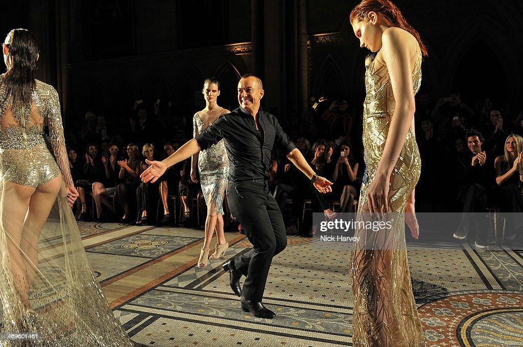 Julien Macdonald and models walks the runway at the Julien Macdonald show at London Fashion Week AW14 at Royal Courts of Justice Strand on February...