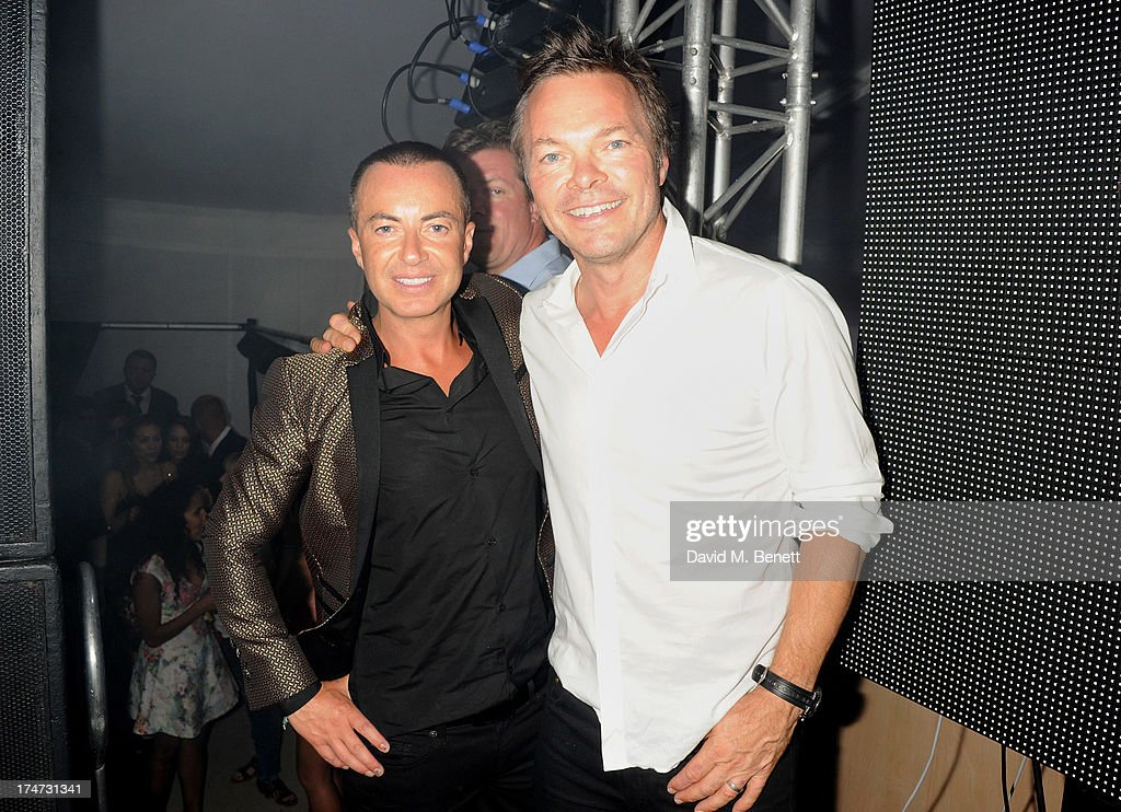 Julien Macdonald (L) and Pete Tong attend the Boujis Party at the Audi International Polo day at Guards Polo Club on July 28, 2013 in Egham, England.