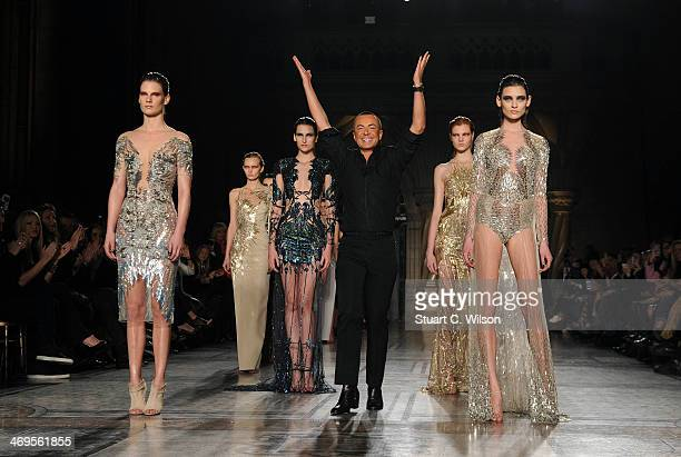 Julien Macdonald walks the runway with models after his show at London Fashion Week AW14 at Royal Courts of Justice Strand on February 15 2014 in...