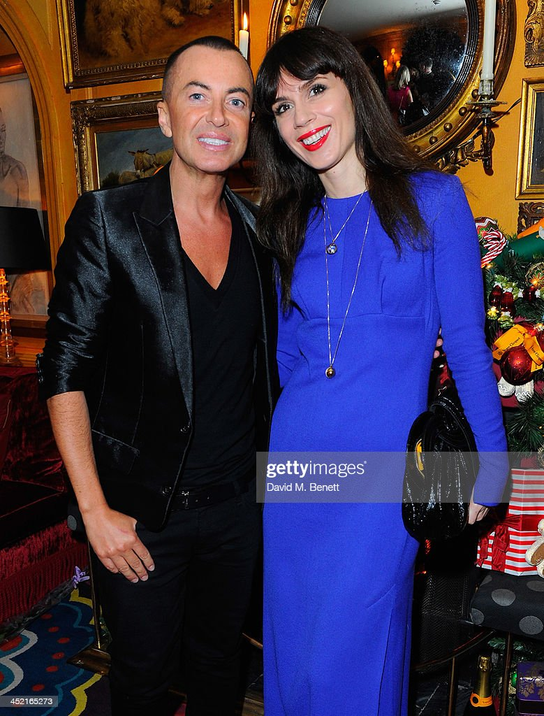 Julien McDonald and Lara Bohic attend Veuve Clicquot Style Party at Annabel's on November 26, 2013 in London, England.