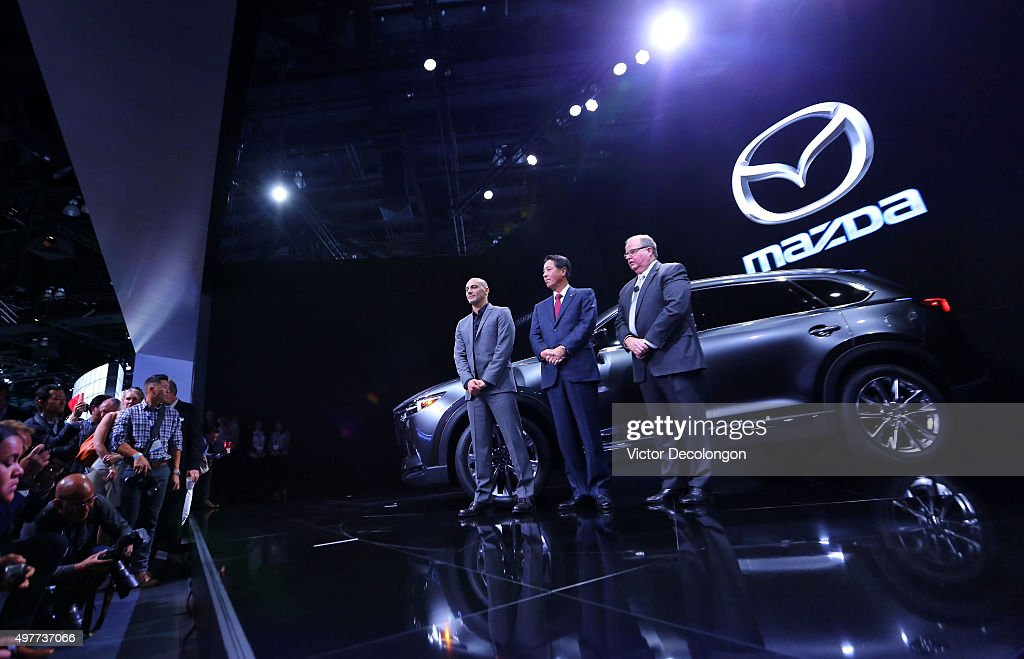 Julien Montousse, Design Director for Mazda Northa America Operations, <a gi-track='captionPersonalityLinkClicked' href=/galleries/search?phrase=Masamichi+Kogai&family=editorial&specificpeople=10904432 ng-click='$event.stopPropagation()'>Masamichi Kogai</a>, President & CEO, Mazda, and Jim O'Sullivan, Presdient & CEO for Mazda North American Operations pose with the all-new Mazda CX-9 during the L.A. Auto Show on November 18, 2015 in Los Angeles, California. A three-row midsized crossover SUV featuring the latest SKYACTIV technology and KODOÑSoul of Motion design, the all-new Mazda CX-9 is a high-end model of MazdaÕs new-generation line-up. With the all-new CX-9, Mazda is proposing a new kind of a crossover SUV aimed at more mature families. Offering an indulgent experience of quality and comfort, the model goes beyond specs and functionality to support and enhance every aspect of customersÕ busy and multi-faceted livesÑnot just their role as a parent.