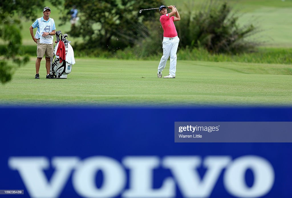 Julien Quesne of France plays his second shot into the 13th green during the first round of the Volvo Golf Champions at Durban Country Club on January 10, 2013 in Durban, South Africa.