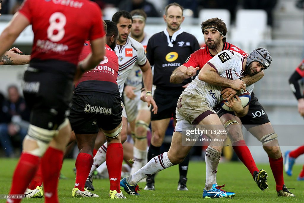 Julien Rey of Union Bordeaux Begles is tackled by Juan Martin Fernandez Lobbe of RC Toulon in action during the Top 14 rugby match between Union Bordeaux Begles and RC Toulon at Stade Matmut Atlantique on February 14, 2016 in Bordeaux, France.