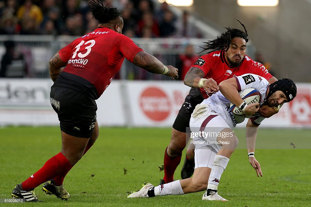 Julien Rey of Union Bordeaux Begles is tackled by Ma a Nonu of RC Toulon during the Top 14 rugby match between Union Bordeaux Begles and RC Toulon at Stade Matmut Atlantique on February 14, 2016 in Bordeaux, France.