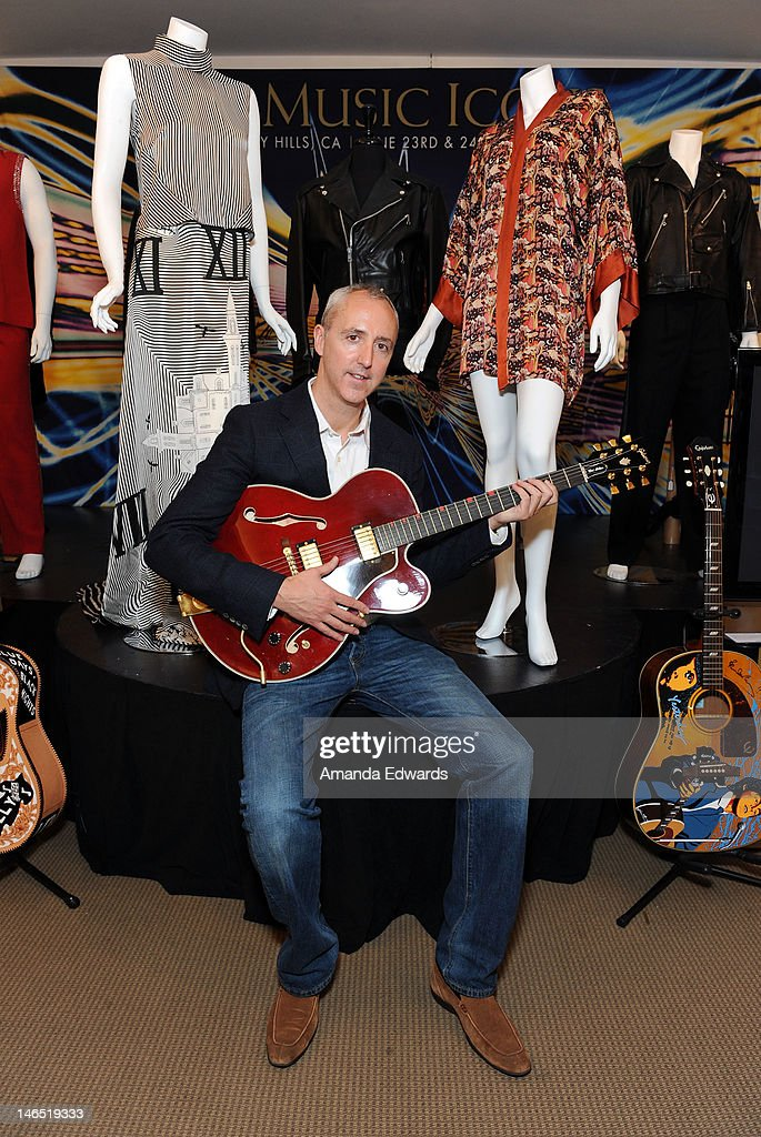 Julien's Auctions Executive Director Martin J. Nolan poses with David Bowie's Chet Atkins Country Gentleman Gibson Guitar at the Julien's Auctions press call for Music Icons And Sports Legends Memorabilia Auction at Julien's Auctions Gallery on June 18, 2012 in Beverly Hills, California.