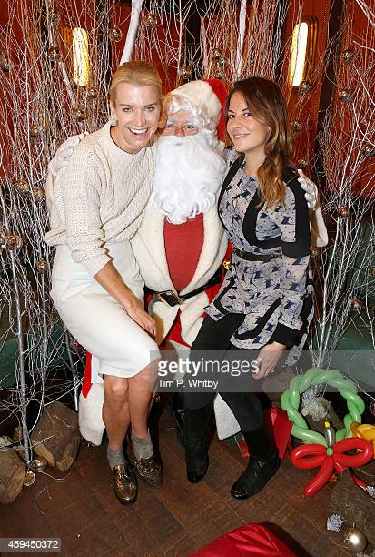 Juliet Angus and Julie Montagu pose for a photo with Father Christmas at the brunch launch of The Ivy Market Grill in partnership with the Kids...