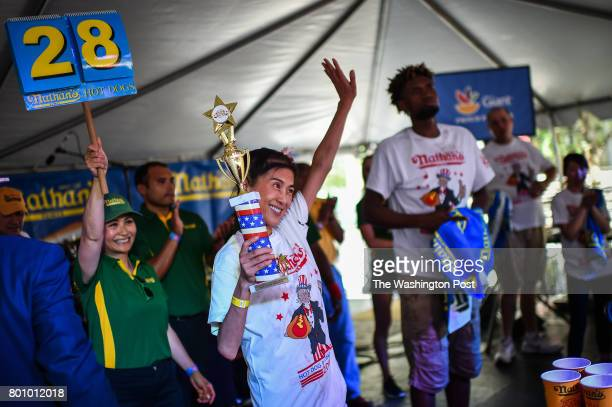 Juliet Lee of Germantown MD wins top female after eating 28 hot dogs in the 2017 Hot Dog Eating Contest qualifier on Saturday June 24 in Washington...