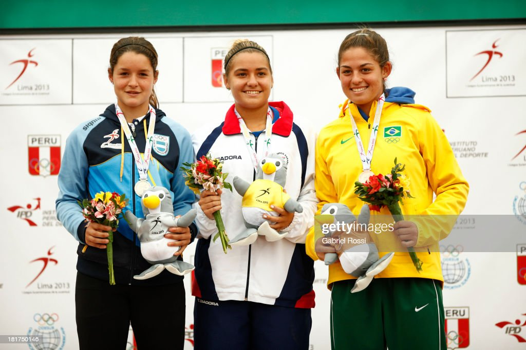 Julieta Estable of Argentina, Camila Giangreco of Paraguay and Carolina Alves of Brazil poses with the medals after the Final match as part of the I ODESUR South American Youth Games at Club Lawn Tenis de la Exposici?n on September 24, 2013 in Lima, Peru.