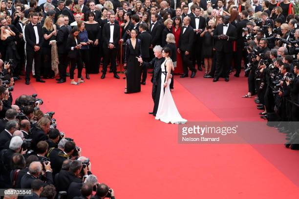 Juliette Binoche and director Christopher Doyle attend the 'Amant Double ' screening during the 70th annual Cannes Film Festival at Palais des...
