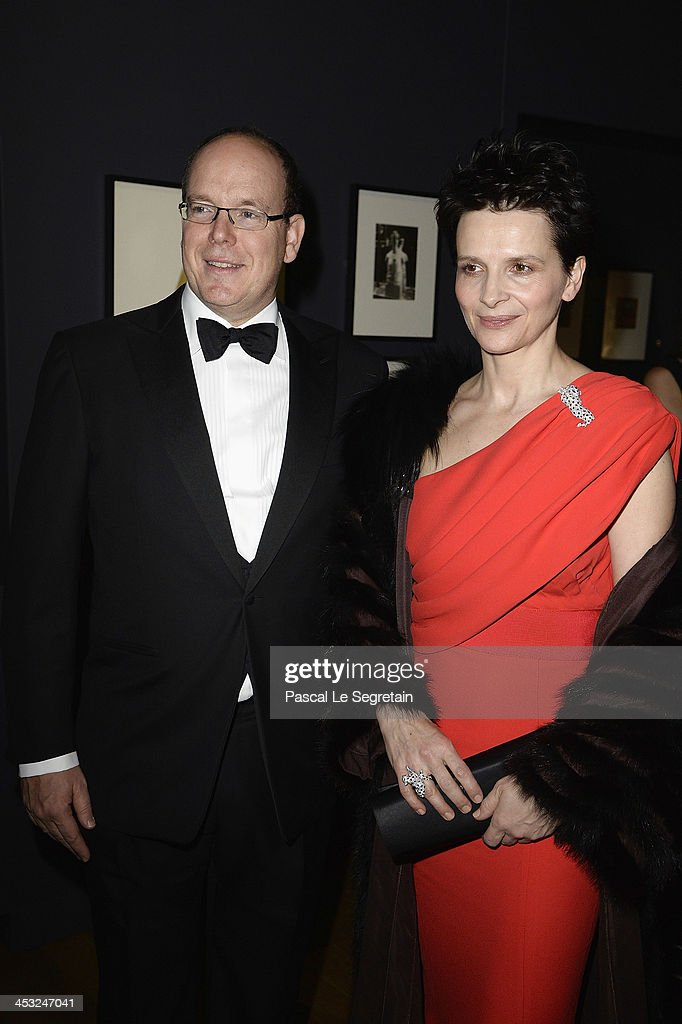Juliette Binoche and Prince Albert II of Monaco arrive at the 'Cartier: Le Style et L'Histoire' Exhibition Private Opening at Le Grand Palais on December 2, 2013 in Paris, France.