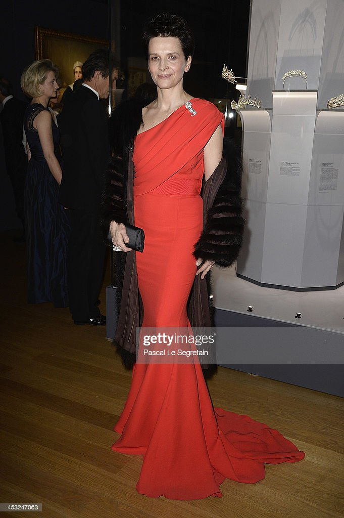 Juliette Binoche arrives at the 'Cartier: Le Style et L'Histoire' Exhibition Private Opening at Le Grand Palais on December 2, 2013 in Paris, France.