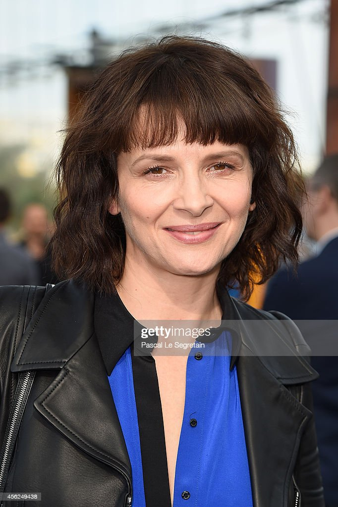 Juliette Binoche attends the Maxime Simoens show as part of the Paris Fashion Week Womenswear Spring/Summer 2015 on September 28 2014 in Paris France