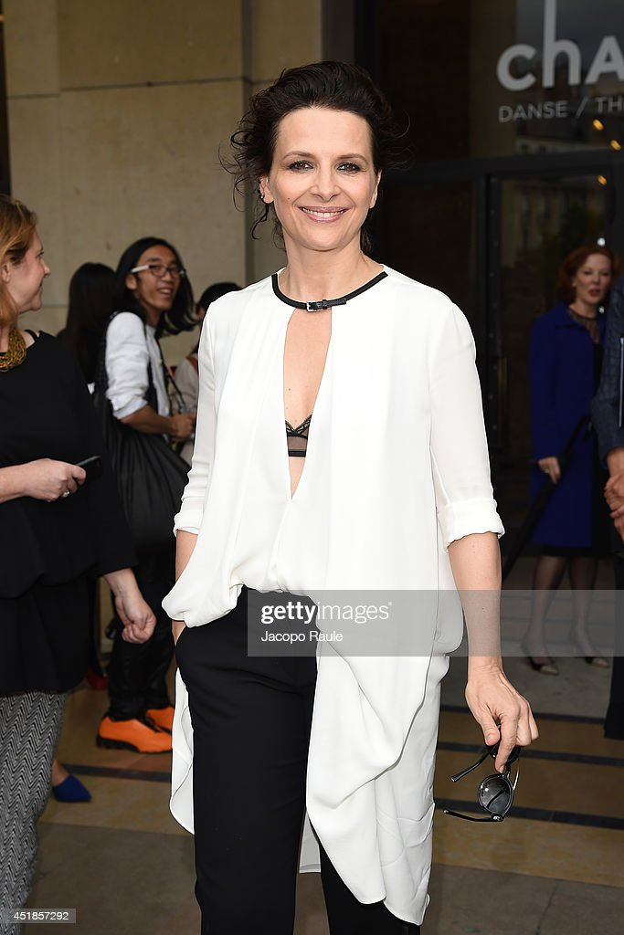 Juliette Binoche leaves the Giorgio Armani Prive show as part of Paris Fashion Week Haute Couture Fall/Winter 20142015 at Theatre National de...
