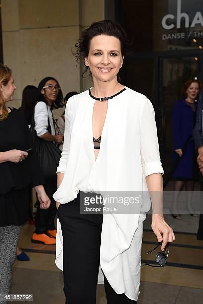 Juliette Binoche leaves the Giorgio Armani Prive show as part of Paris Fashion Week Haute Couture Fall/Winter 20142015 at Theatre National de...
