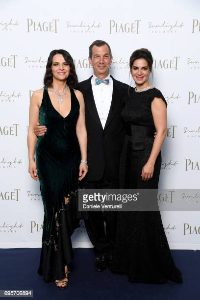 Juliette Binoche Philippe LeopoldMetzger and Chabi Nouri attend Piaget Sunlight Journey Collection Launch on June 13 2017 in Rome Italy