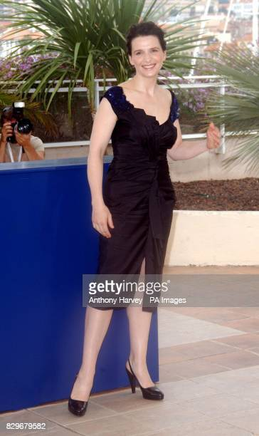 Juliette Binoche poses for photographers during the photocall for 'Cache'