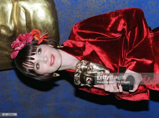 Juliette Binoche sheds a tear after receiving her BAFTA award for Best Performance by an Actress in a supporting role in The English Patient at the...