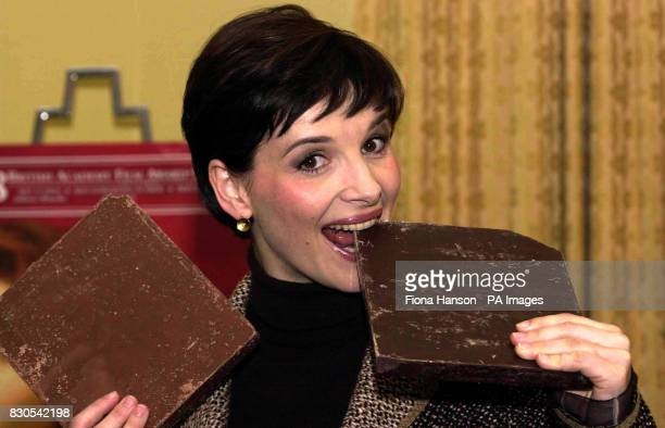 Juliette Binoche sinks her teeth into a bar of chocolate at Claridges Hotel Central London after learning she had landed a Best Actress Academy...