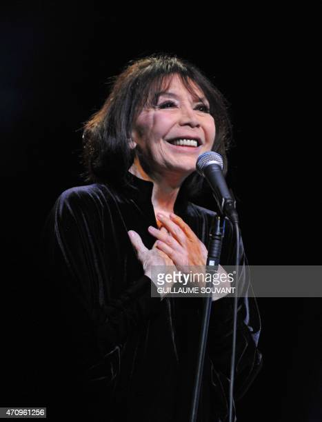Juliette Greco French singing icon and one of the last living links to the postwar Parisian Latin Quarter jazz scene performs on stage for the...