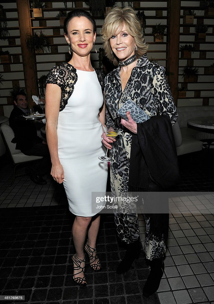 Juliette Lewis and Jane Fonda attend the Weinstein Company's holiday party at RivaBella on November 21, 2013 in West Hollywood, California.