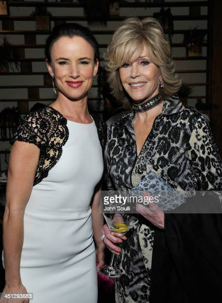 Juliette Lewis and Jane Fonda attend the Weinstein Company's holiday party at RivaBella on November 21 2013 in West Hollywood California