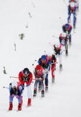 Julija Tchepalova of Russia Katerina Neumannova of the Czech Republic and Evi Sachenbacher Stehle of Germany compete in the Womens Cross Country...