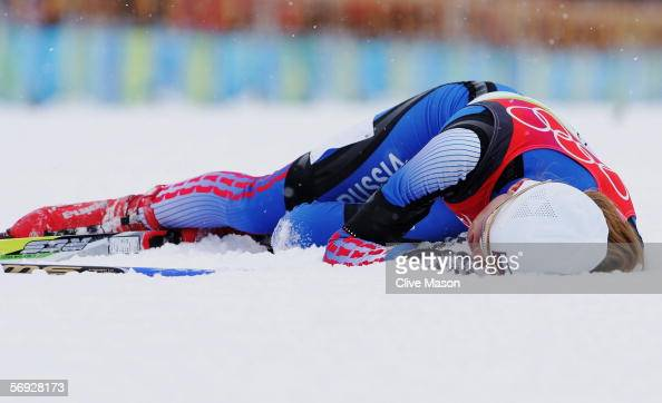 Julija Tchepalova of Russia lays exhausted at the end of the Womens Cross Country Skiing 30km Mass Start Final on Day 14 of the 2006 Turin Winter...