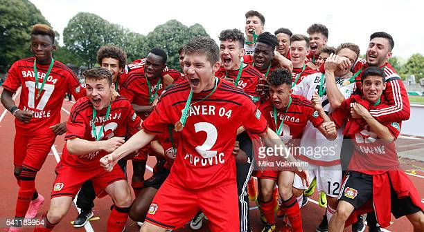 Julijan Popovic of Leverkusen and teammates celebrate the win of the cup after the U17 German Championship Final match between Borussia Dortmund U17...