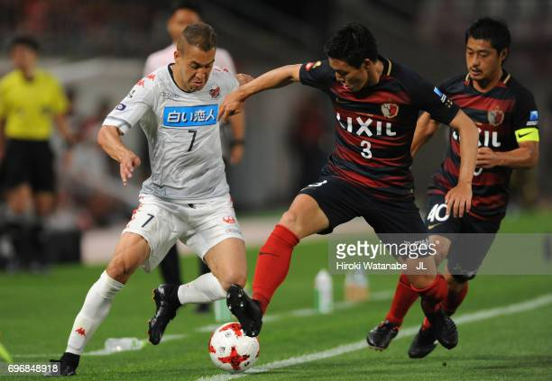 Julinho of Consadole Sapporo and Gen Shoji of Kashima Antlers compete for the ball during the JLeague J1 match between Kashima Antlers and Consadole...