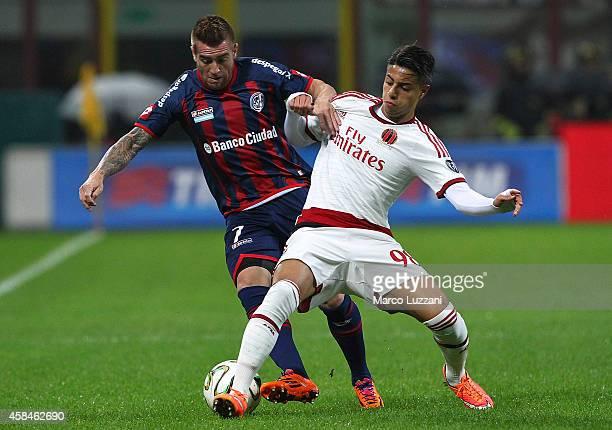 Julio Alberto Buffarini of San Lorenzo competes for the ball with Hachim Mastour of AC Milan during Luigi Berlusconi Trophy at Stadio Giuseppe Meazza...