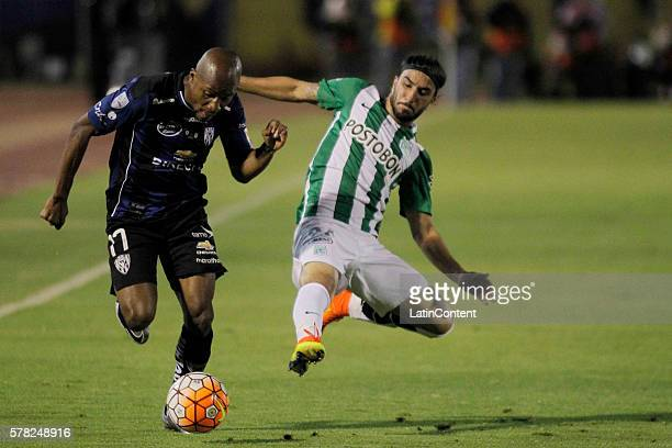 Julio Angulo of Independiente del Valle battles for the ball with Sebastian Perez of Atletico Nacional during a first leg final match between...