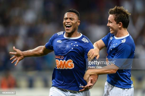 Julio Baptista and Dagoberto of Cruzeiro celebrate during the match between Cruzeiro v Real Garcilaso for the Copa Briedgestone Liberators 2014 at...