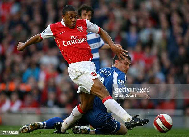 Julio Baptista of Arsenal gets his shot in ahead of Graeme Murty of Reading to score his sides second goal during the Barclays Premiership match...